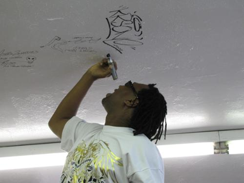 KRS-ONE signs the Ceiling of Fame!
